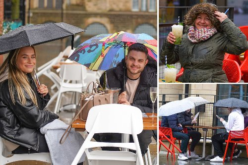 Beer garden Brits brave torrential rain to hit the pubs in weather washout