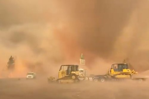Terrifying moment fire tornado ripped up trees as firefighters take on wildfires