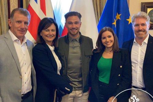 Cash poses at Polish embassy as he starts plan switch international allegiance