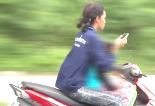 Teen crashes motorbike into parked car while looking at phone