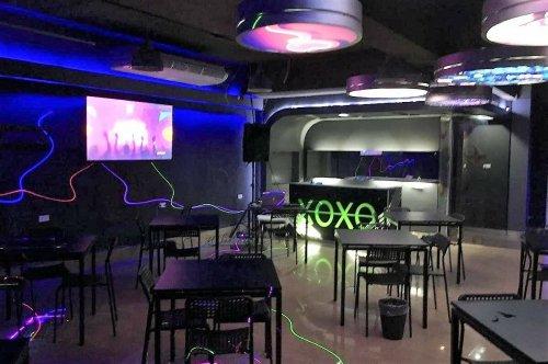 Over 100 customers, bar manager charged in Bangkok pub raid