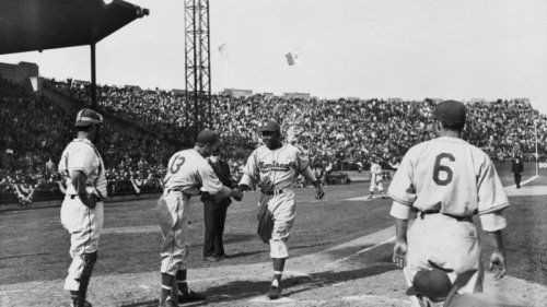 A handshake from a white teammate signaled Jackie Robinson's arrival in America's game