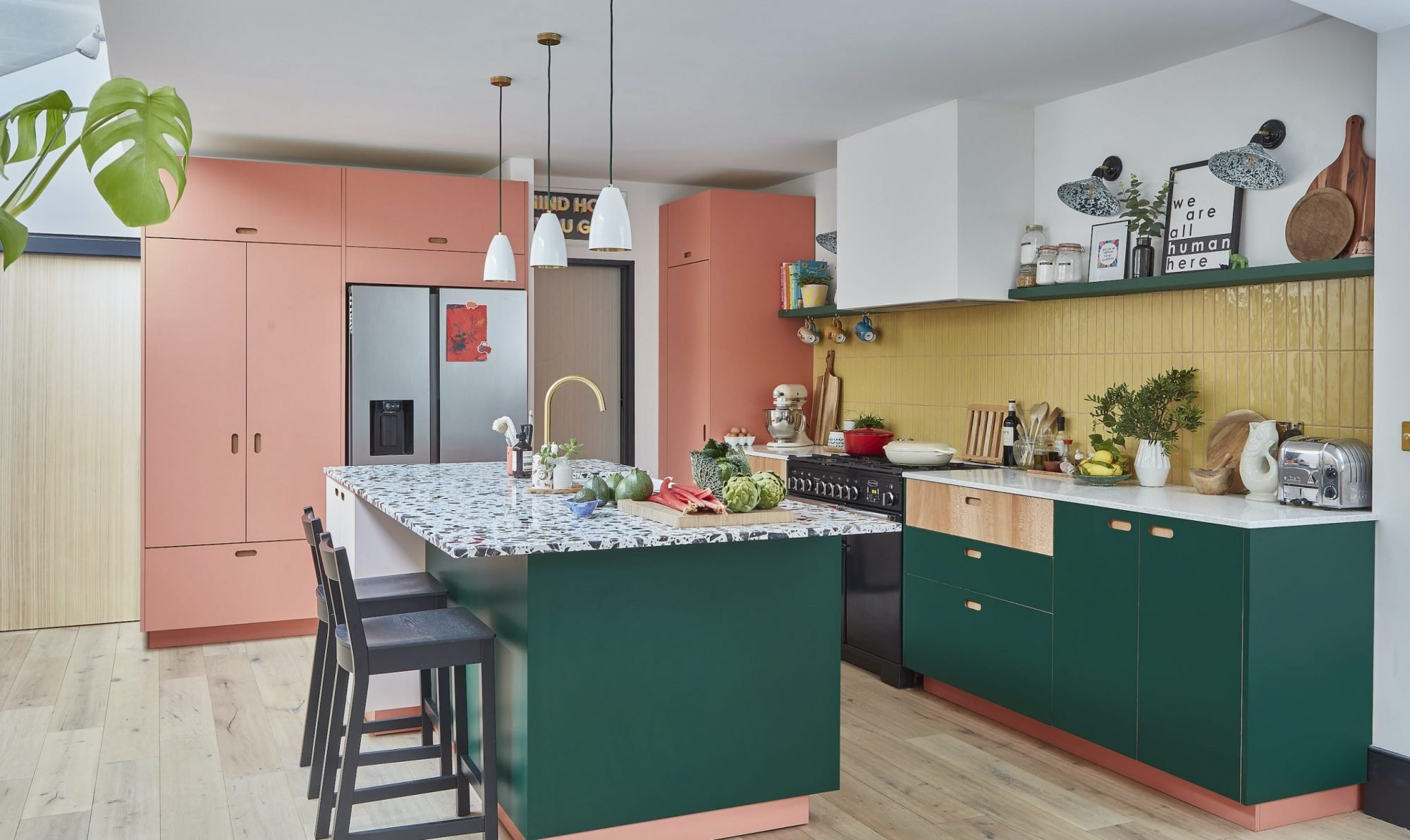 Before and after: Rainbow colours have transformed a tired kitchen into a vibrant space
