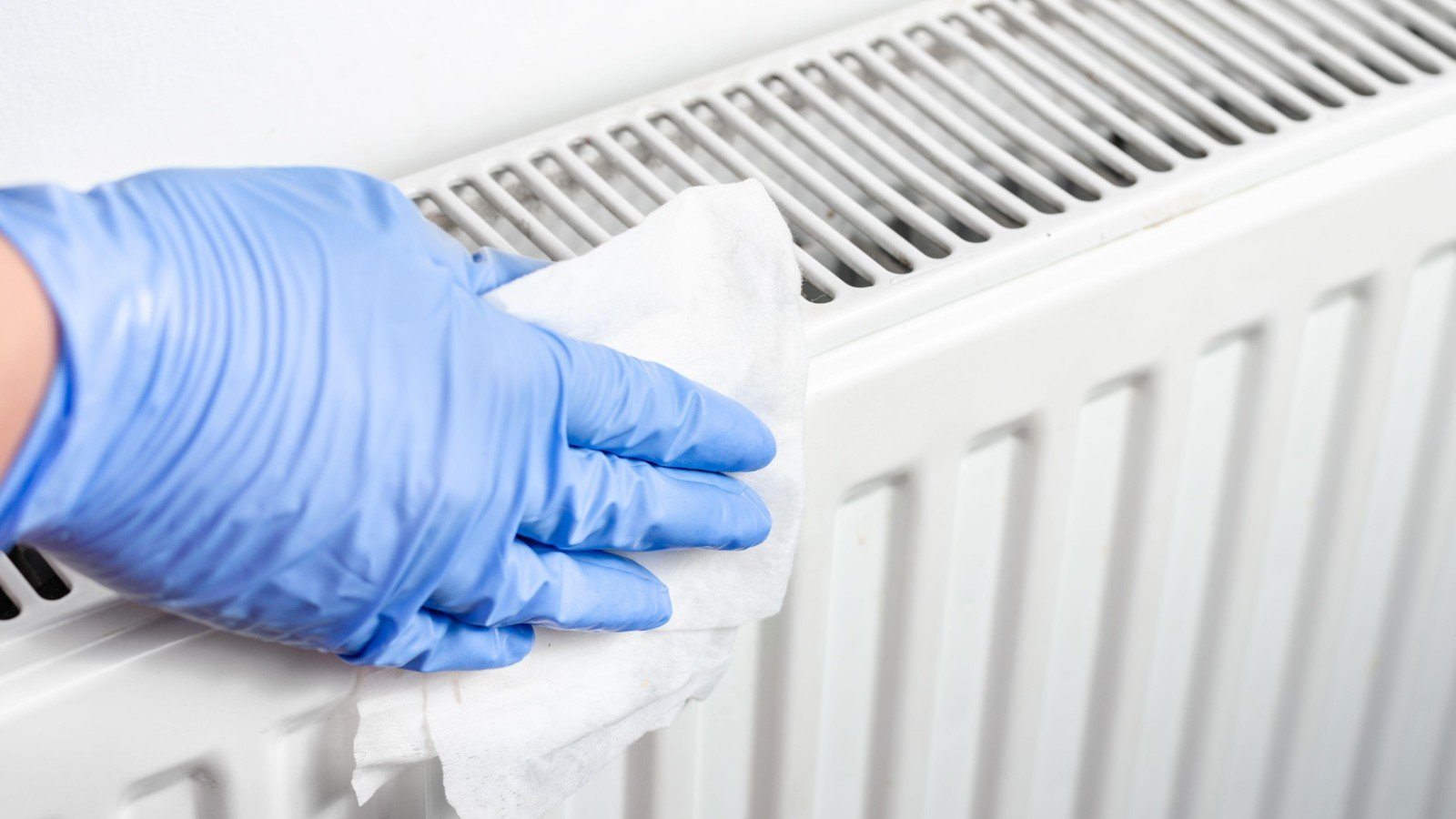 Easy and cheap hack to clean the pesky dust behind radiators
