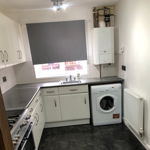 See how this drab kitchen was given a brilliant blue makeover for just £300