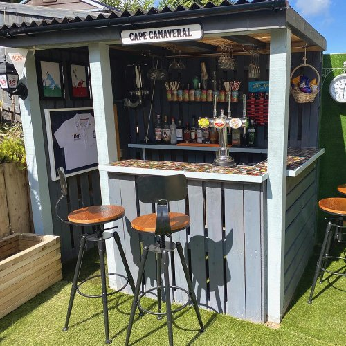 See how one savvy couple created the ultimate garden bar – including a bottle top counter