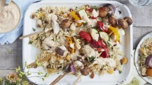 BBQ vegetables with red pesto dressing and couscous