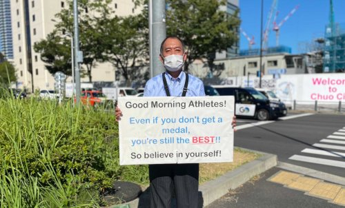 This man stands outside the Tokyo Olympic Village every day to motivate athletes