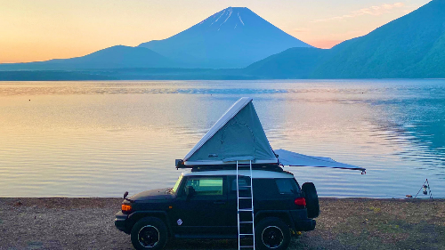 Go on a road trip across Japan in a fully equipped camping car with a rooftop tent