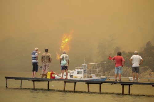 Tourists, villagers evacuated by boats as wildfires ravage Turkish resorts