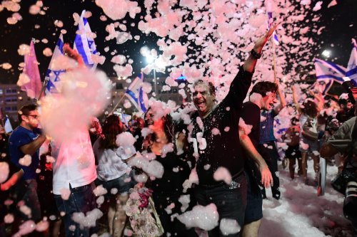 Thousands in Tel Aviv celebrate ousting Netanyahu with foam, confetti and flags