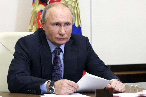 Putin says report Russia to sell Iran advanced spy satellite is 'garbage'