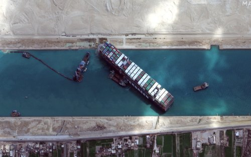 Egypt delays attempt to dislodge megaship from Suez, says it needs more tugboats