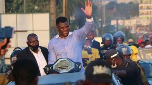 Francis Ngannou Mobbed in Cameroon!!! ... Shows Off UFC Belt!