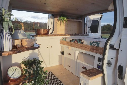 Couple Travels In Compact Van Conversion With Two Housecats