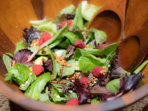 Raspberry Chevre Green Salad With Toasted Pine Nuts