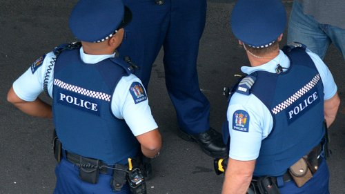 Auckland cop's face cut after man punches through glass door