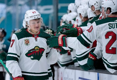 With playoff berth in hand, Wild take aim at division title