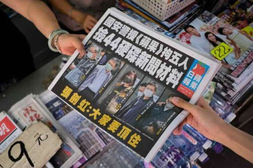 Hong Kong democracy paper defiant as executives charged under security law