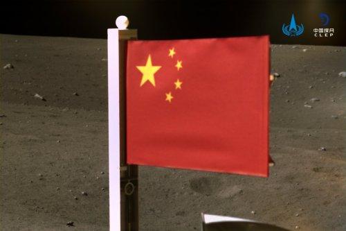 China unfurls its first fabric flag on moon