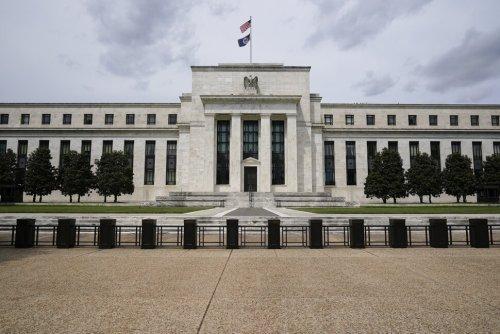 Fed Holds Firm on Interest Rates, Says Economy Strengthening   Economy   US News