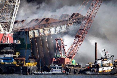 Damage Assessment Begins on Overturned Cargo Ship After Fire