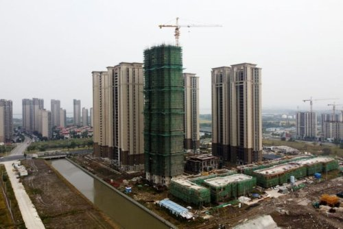 Factbox-China's Indebted Property Market and the Evergrande Crisis