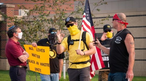 Masked Proud Boys Show Up at a School Board Meeting to Protest Critical Race Theory
