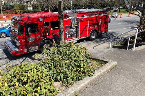 Saanich fire crews close road over smoking sidewalk - Victoria News