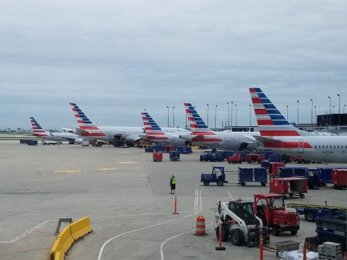 Family Traveling Home From Funeral Watches As American Airlines Gives Their Seats Away - View from the Wing