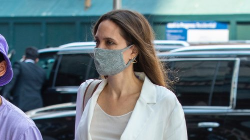 Angelina's Swaps Summer Black For A Slouchy White Suit