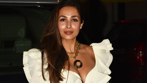 Malaika Arora paired her jeans with a flirty white ruffled crop top for a night out