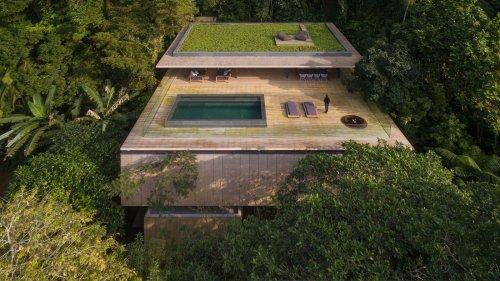 Stunning modern house in Brazil's rain forest has cozy sunken living room, green roof