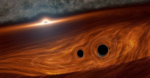 Astronomers see first light flare from two distant black holes colliding