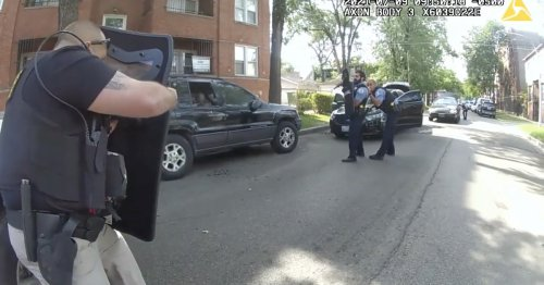 Video shows tense moments of police shooting, with cops yelling to stay clear as they fire dozens of rounds at suspect