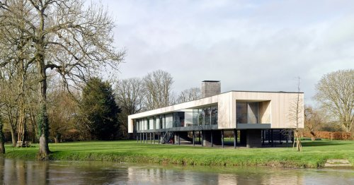 Riverfront house on stilts is ready to float above flood water
