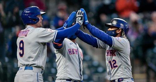 Mets split doubleheader with Rockies