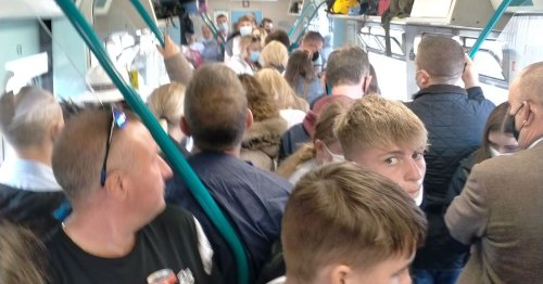 'They were still trying to ram more on': Onboard a packed train