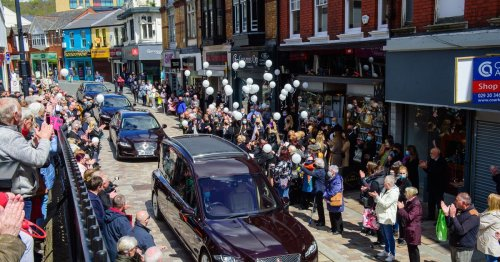 Coffin lies in cafe as hundreds line streets to say goodbye to 'best boss'