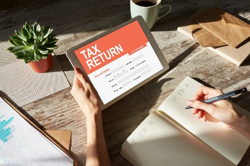 TaxAct vs TurboTax: Which One Is Better? | WalletGenius