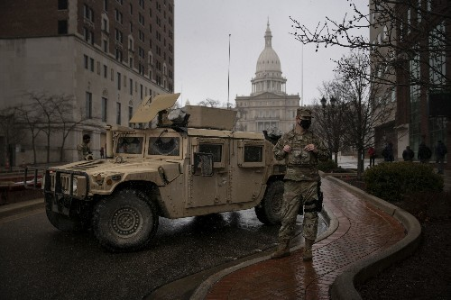 State capitol protests mostly small, but under heavy guard from troops and law enforcement