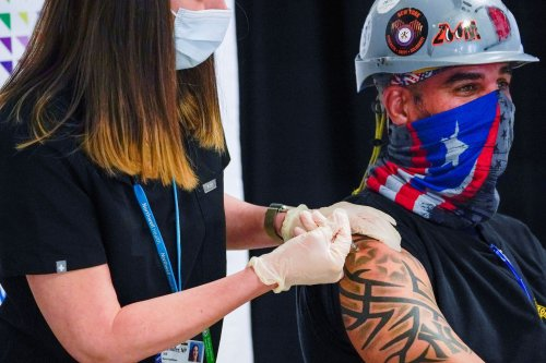 Covid-19 live updates: Top federal science adviser says 'nothing should detract' from Americans getting vaccinated