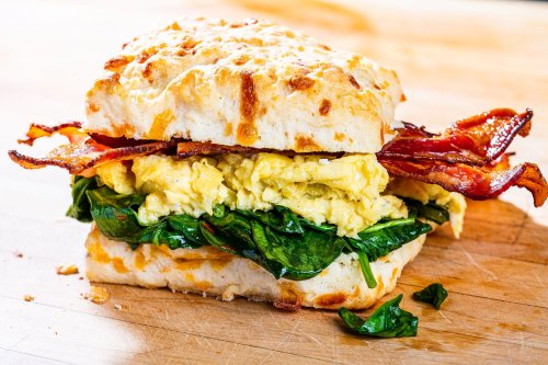 Cheddar biscuits loaded with eggs, bacon and spinach are why we love breakfast for dinner