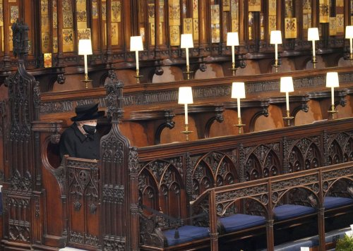 Image of Queen Elizabeth II sitting alone at Philip's funeral breaks hearts around the world
