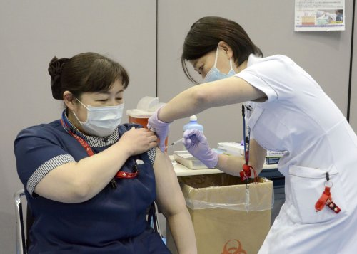 Why is Japan failing so badly on vaccinations?