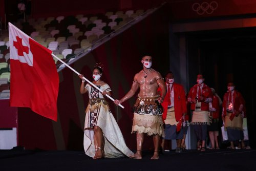 Tonga's shirtless flag bearer is back at the Olympics, but this time he has competition