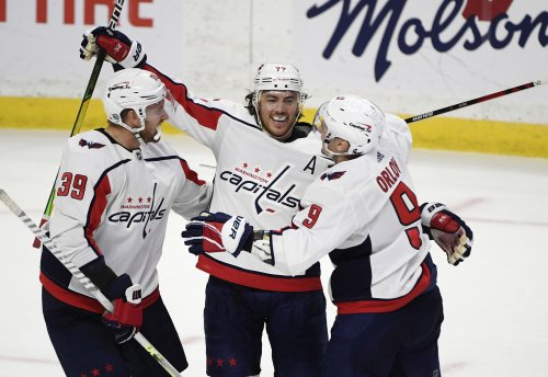 T.J. Oshie notches a hat trick as the Capitals win a wild one over the Senators, 7-5