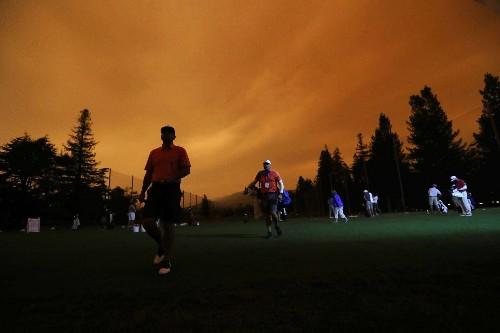 PGA Tour golfers play amid orange skies, smoky conditions because of California wildfires
