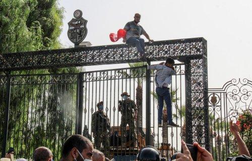 Influential voices in Egypt, Saudi Arabia and UAE celebrate Tunisia turmoil as blow to political Islam