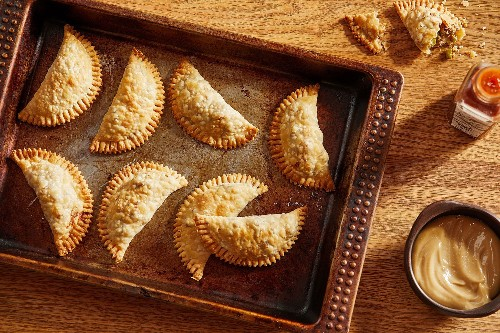 Shareable recipes for socially distant gatherings, including empanadas, slab pies and quesadillas